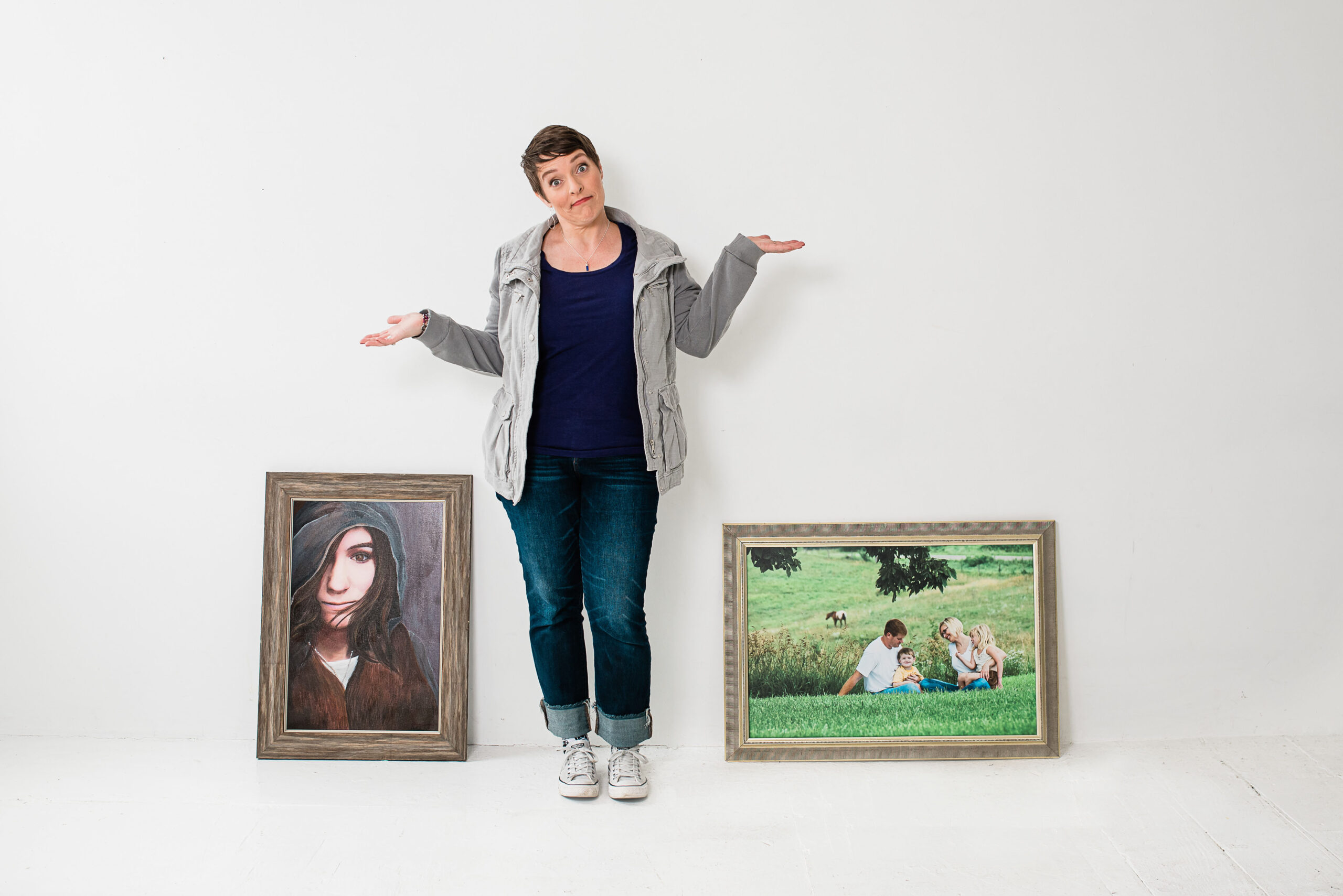 Woman showing why not with framed portraits